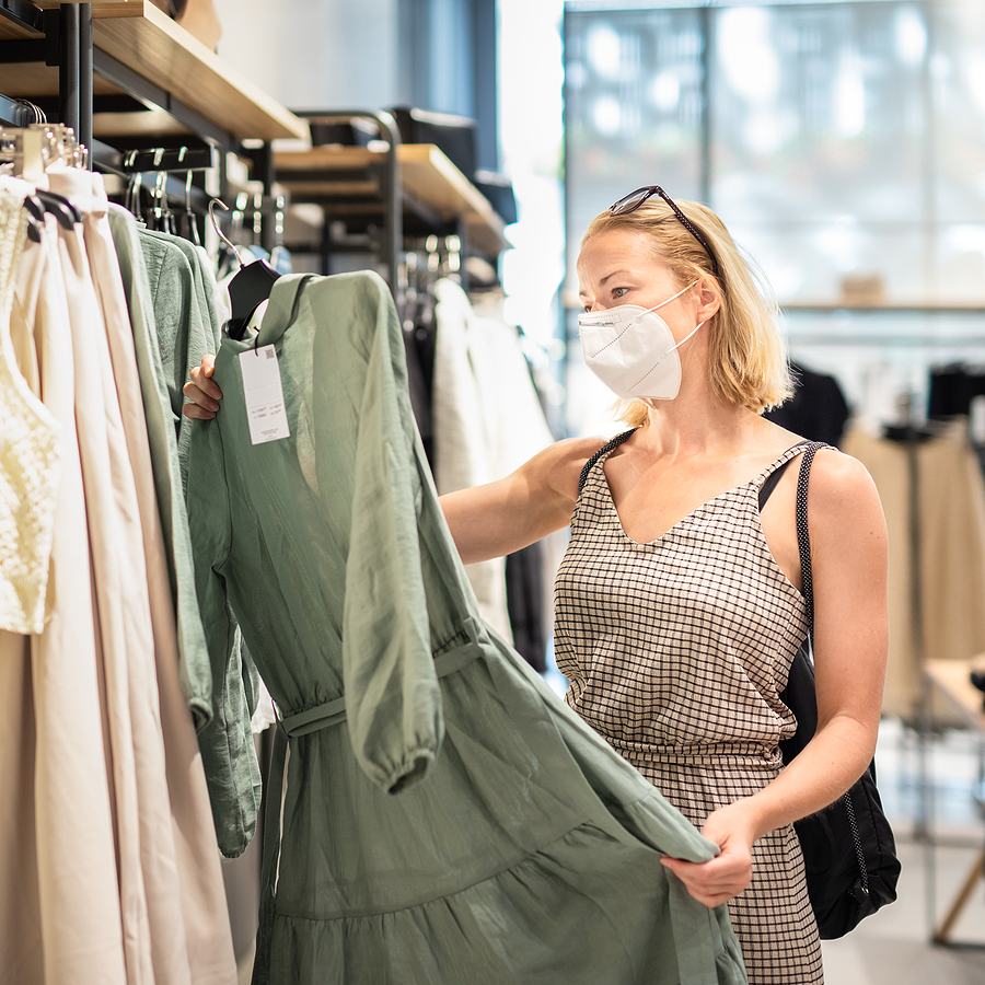 Woman checking a dress inside a clothing store in Willows