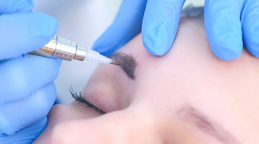 Cosmetologist Doing An Eyebrows Microblading Procedure