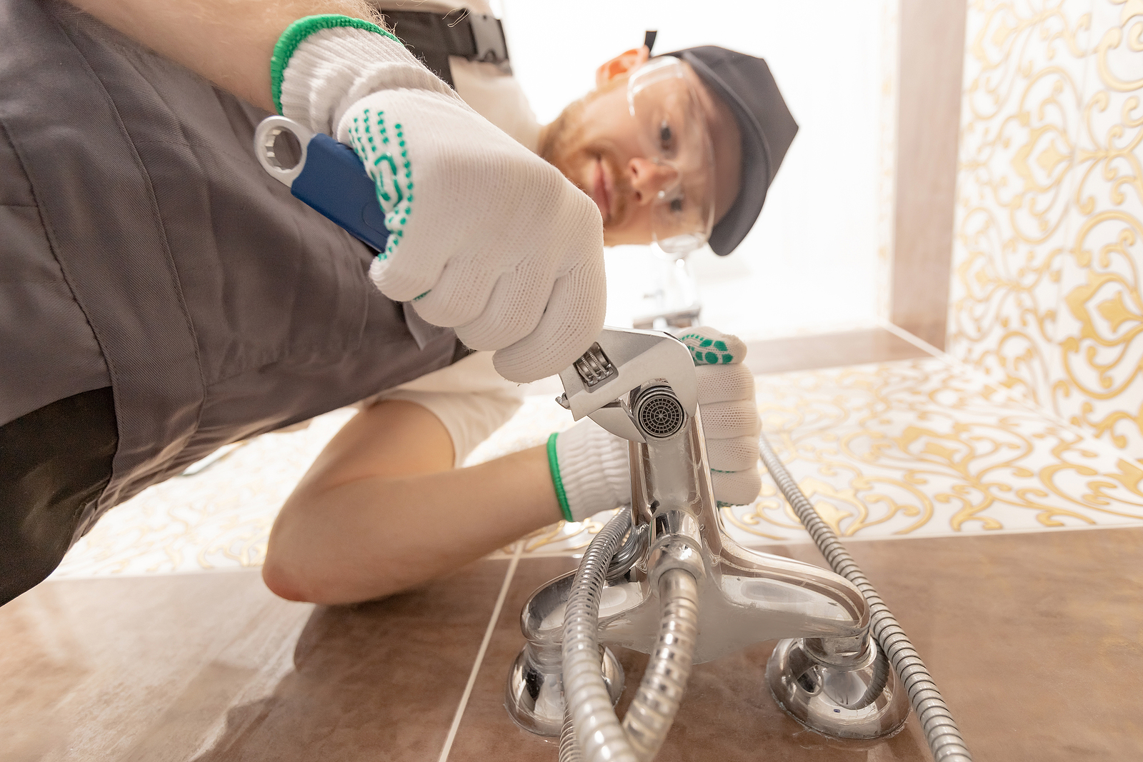 Professional Canberra plumber installing a shower stall