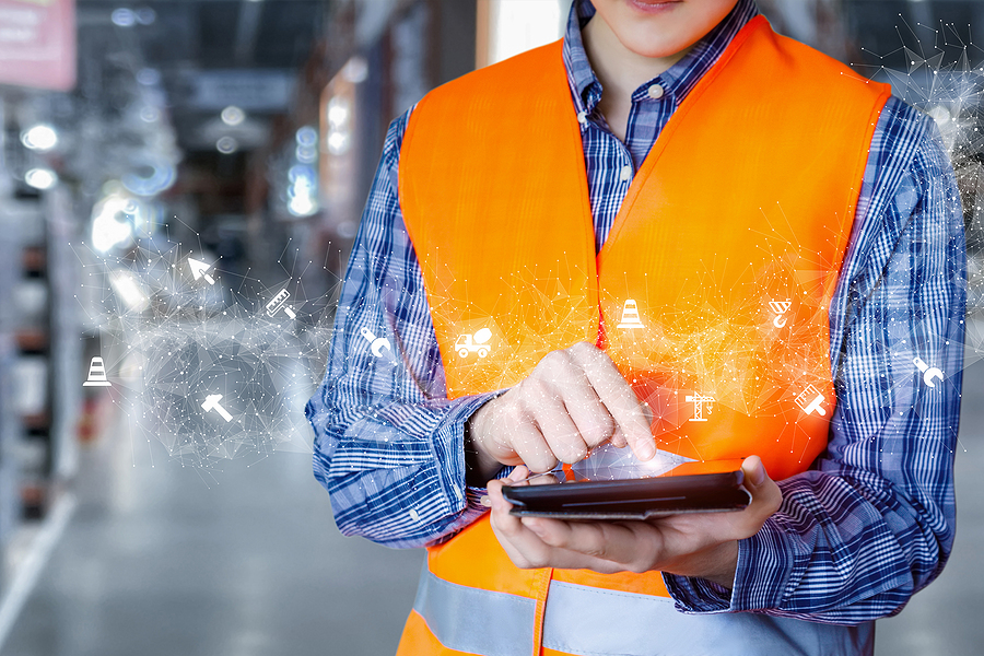 Worker using construction project management software